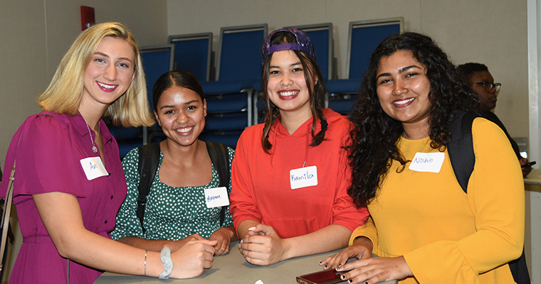 Four students who earned a spot on the Dean's list celebrating.