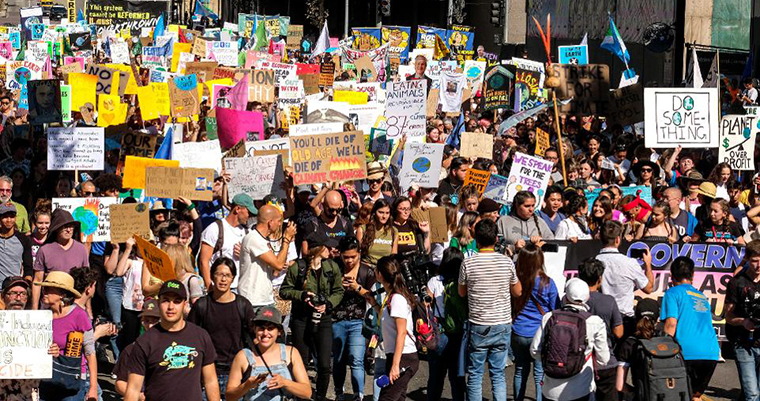 Group of individuals protesting climate change.