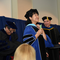 A PhD candidate in the College of Education and Human Development at the hooding ceremony